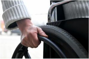 Photo of hands on a wheelchair